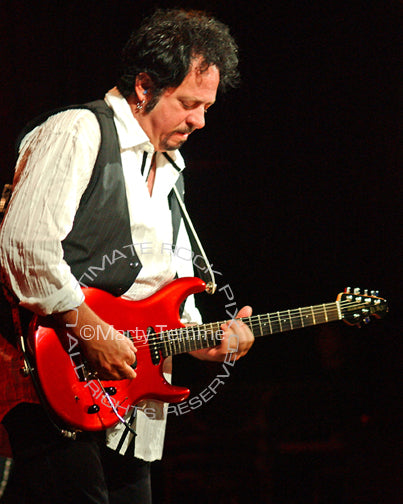 Photo of Steve Lukather of Toto in concert in 2008 by Marty Temme