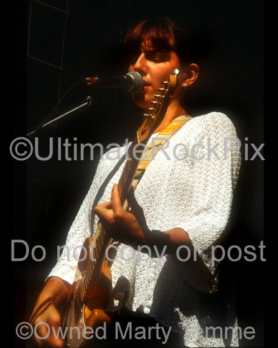 Photo of Emma Anderson of Lush in concert in 1992 by Marty Temme