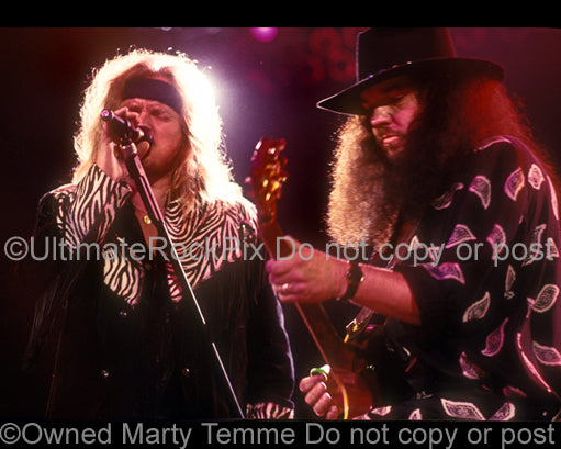 Photo of Johnny Van Zant and Gary Rossington of Lynyrd Skynyrd in 1991 by Marty Temme