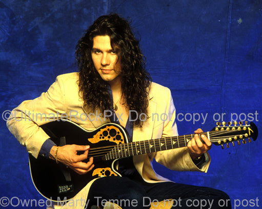 Photo of Mark Slaughter playing an Ovation acoustic guitar during a photo shoot in 1992 by Marty Temme