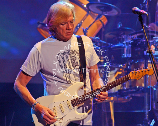 Photo of Justin Hayward of The Moody Blues playing a Stratocaster in concert by Marty Temme
