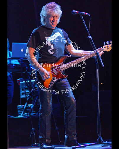 Photo of John Lodge of The Moody Blues playing bass in concert by Marty Temme