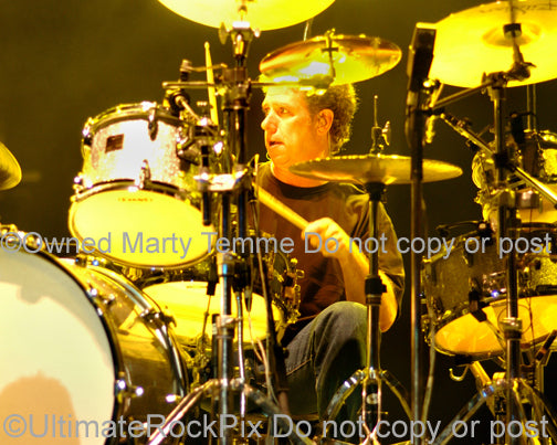 Photo of drummer Mickey Curry of Bryan Adams in concert by Marty Temme