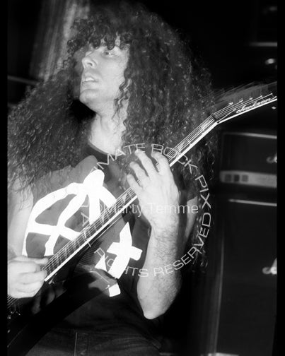 Photo of guitarist Marty Friedman of Megadeth in concert in 1990 by Marty Temme