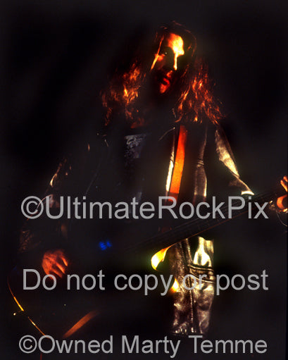 Photo of bassist Paul Barker of Ministry in concert in 1992 by Marty Temme