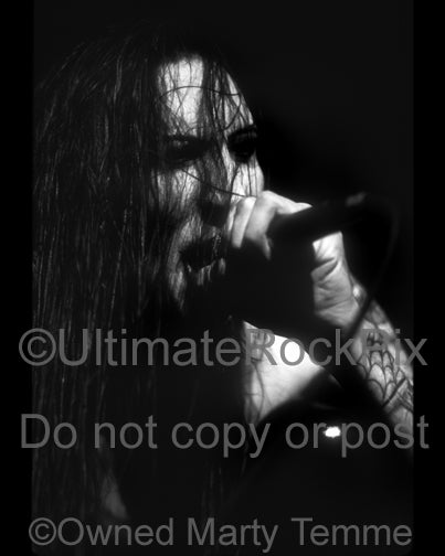 Black and white photo of singer Marilyn Manson in concert in 1995