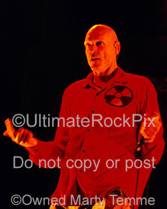 Photo of singer Peter Garrett of Midnight Oil in concert in 2002 by Marty Temme