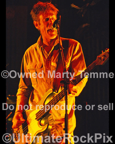 Photo of bassist Bones Hillman of Midnight Oil in concert by Marty Temme