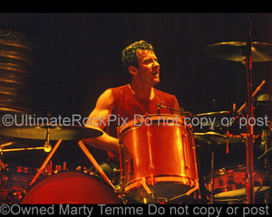 Photo of drummer Rob Hirst of Midnight Oil in concert in 2002 by Marty Temme