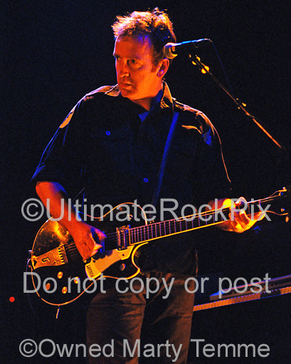 Photo of Jim Moginie of Midnight Oil playing a Gretsch guitar in concert in 2002 by Marty Temme