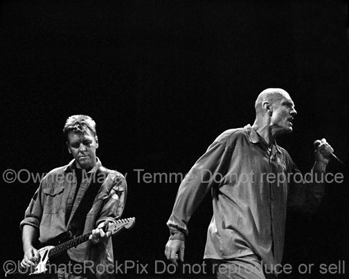 Photo of Martin Rotsey and Peter Garrett of Midnight Oil in concert by Marty Temme