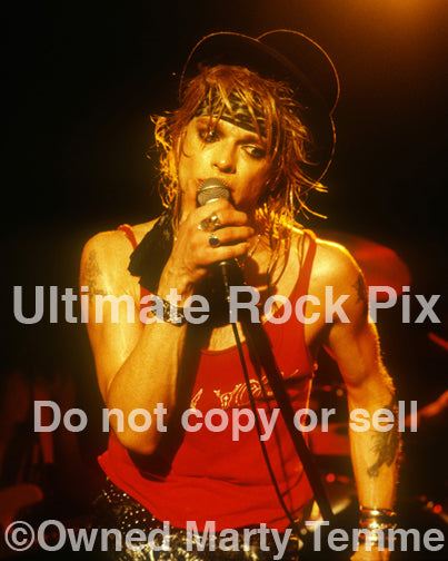 Photo of singer Michael Monroe in concert in 1989 by Marty Temme