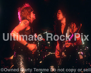 Photo of Michael Monroe performing in concert in 1989 by Marty Temme