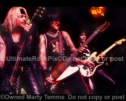 Photos of Vince Neil, Nikki Sixx and Mick Mars of Motley Crue in Concert in 2000 by Marty Temme