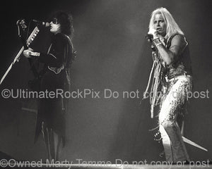 Photo of Nikki Sixx and Vince Neil of Motley Crue in concert in 1985 by Marty Temme