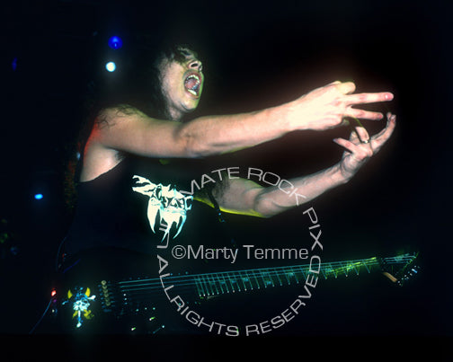 Photo of Kirk Hammett of Metallica playing an ESP guitar in concert in 1989 by Marty Temme