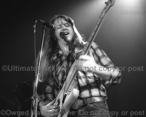 Photo of bassist Tommy Caldwell of The Marshall Tucker Band in concert in 1974 by Marty Temme