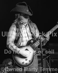 Photo of Toy Caldwell of The Marshall Tucker Band in concert in 1974 by Marty Temme