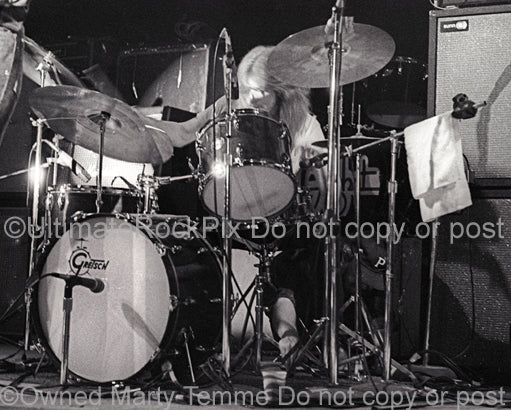 Photo of Paul Riddle of The Marshall Tucker Band playing Gretsch drums in concert in 1974 by Marty Temme