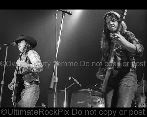 Photo of Toy and Tommy Caldwell of The Marshall Tucker Band in concert in 1974 by Marty Temme