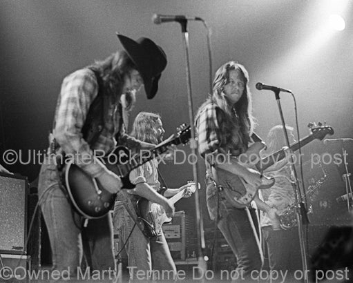Photo of brothers Toy and Tommy Caldwell of The Marshall Tucker Band in concert in 1974 by Marty Temme