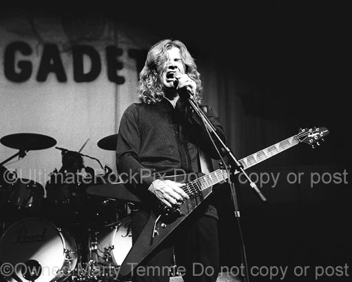 Black and white photo of Dave Mustaine in concert by Marty Temme