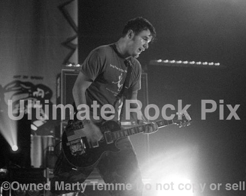 Photo of Chad Gilbert of New Found Glory in concert in 2002 by Marty Temme