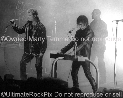 Photo of Trent Reznor of Nine Inch Nails and David Bowie in concert in 1995 by Marty Temme