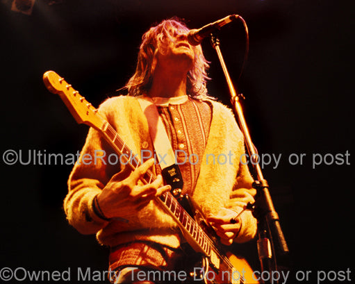 Photo of Kurt Cobain of Nirvana singing and playing guitar onstage in 1991 by Marty Temme