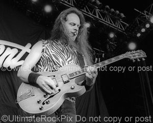 Black and white photo of Ted Nugent in concert in 2000 by Marty Temme