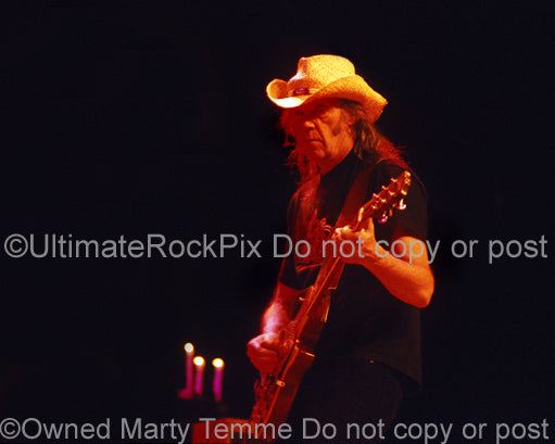 Photo of Neil Young of CSNY playing a Les Paul in concert by Marty Temme