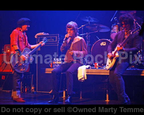 Photo of Sylvain Sylvain, David Johansen and Steve Conte of New York Dolls in concert by Marty Temme