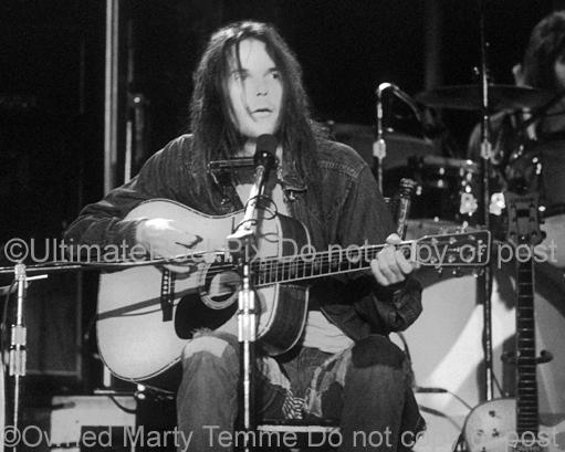 Black and White Photo of Neil Young of CSNY Performing in Concert in 1973 by Marty Temme