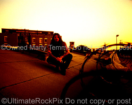 Photo of Scott Weinrich of The Obsessed during a rooftop photo shoot in 1994 by Marty Temme