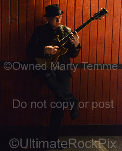 Photo of Chris Poland of Ohm during a photo shoot in 2012 by Marty Temme