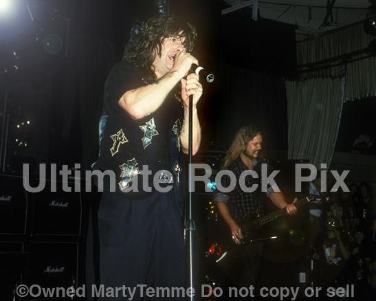 Photo of Ozzy Osbourne performing in concert in 1990 by Marty Temme