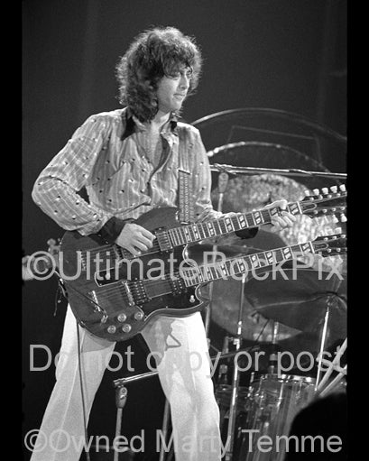 Black and white photo of Jimmy Page playing a Doubleneck SG in concert in 1973 by Marty Temme
