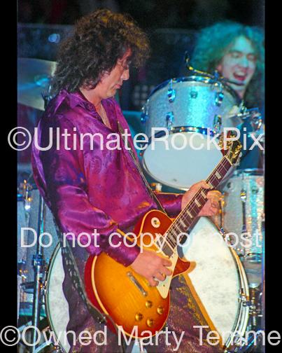 Photos of Jimmy Page of Page and Plant Playing a Gibson Les Paul in Concert in 1995 by Marty Temme