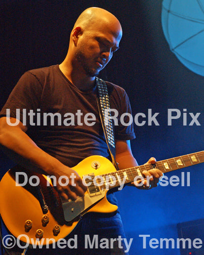 Photo of guitar player Joey Santiago of The Pixies in concert by Marty Temme