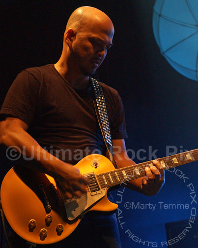 Photo of guitarist Joey Santiago of The Pixies in concert by Marty Temme