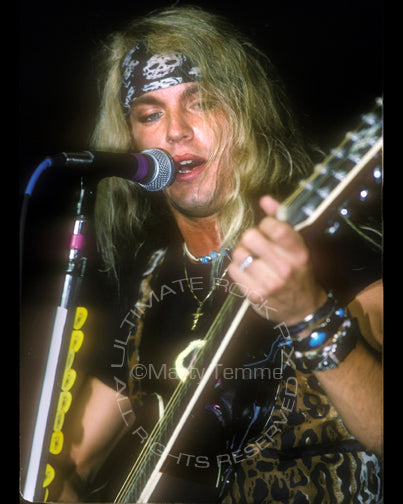 Photo of Bret Michaels of Poison in concert in 1990 by Marty Temme