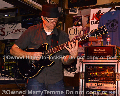 Photo of guitarist Chris Poland of Ohm in concert in 2012 by Marty Temme