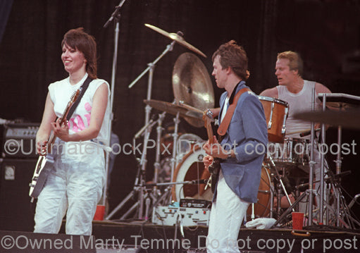 Photo of Chrissie Hynde, Robbie McIntosh and Martin Chambers of The Pretenders in concert in 1983 by Marty Temme