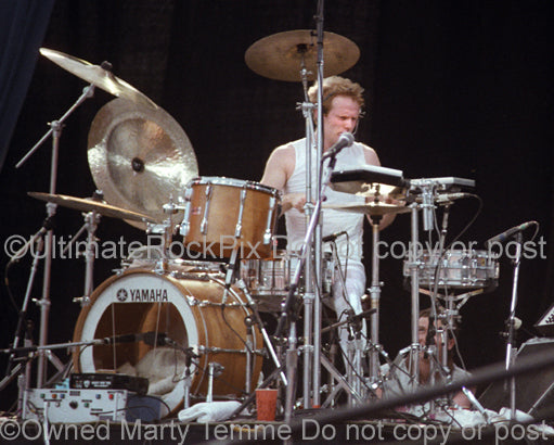 Photo of Martin Chambers of The Pretenders in concert in 1983 by Marty Temme