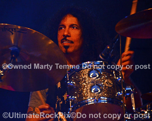 Photo of drummer Frankie Banali of Quiet Riot in concert in 2013 by Marty Temme
