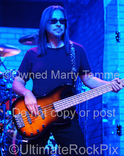 Photo of bassist Eddie Jackson of Queensryche in concert in 2006 by Marty Temme
