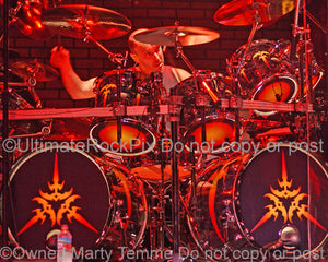 Photo of drummer Scott Rockenfield of Queensryche in concert in 2006 by Marty Temme
