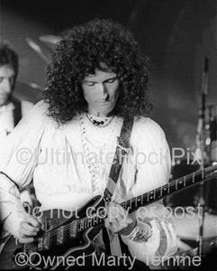 Photos of Brian May of Queen Performing Onstage in 1977 by Marty Temme