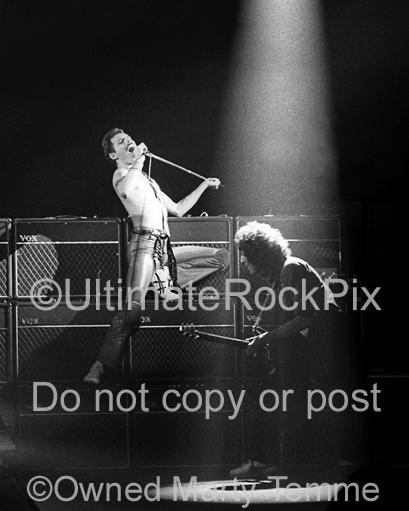 Photo of Freddie Mercury and Brian May of Queen performing together onstage in 1980 by Marty Temme