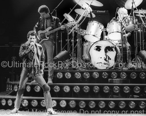 Black and white photo of Freddie Mercury and John Deacon of Queen in 1980 by Marty Temme
